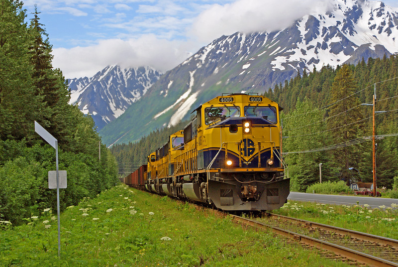 Surrounded by mountains an Alaska empty coal train departs Seward for Anchorage.