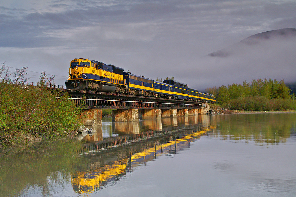 Alaska Railroad's Coastal Classic cruises over 20 Mile River enroute to Seward on a nice spring day.
