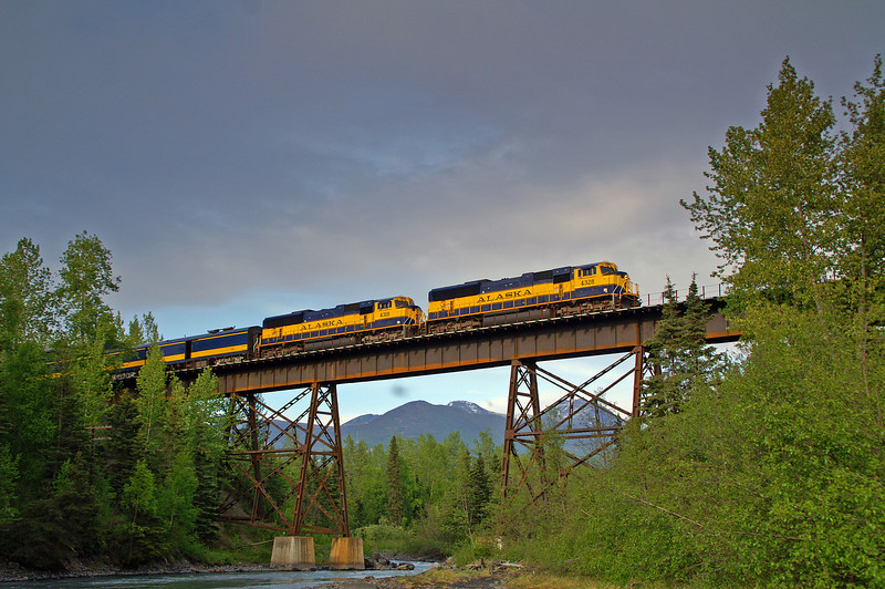 Alaska Railroad's Denali Star Express crosses the Eagle River on a steel trestle. This train is just a few minutes outside of Anchorage.