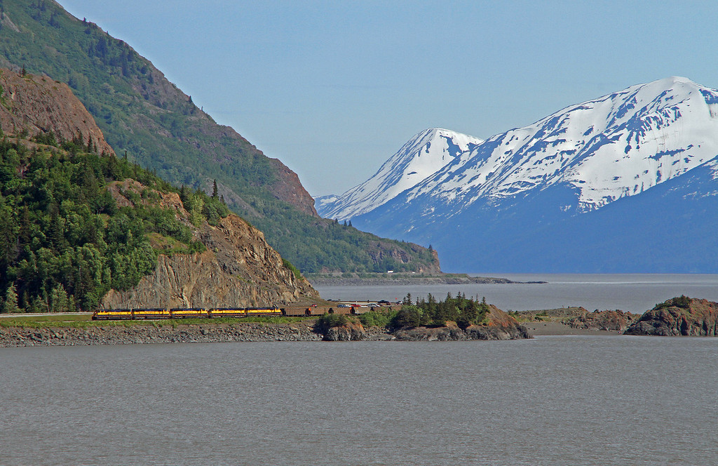 An empty Alaska Railroad train rounds the curve at Beluga Point.