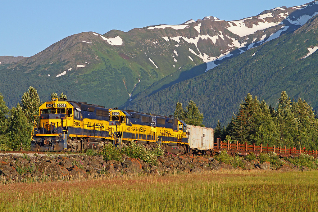 An Alaska work train ends the day basking in the sunshine. It is 9 PM and the light is perfect.
