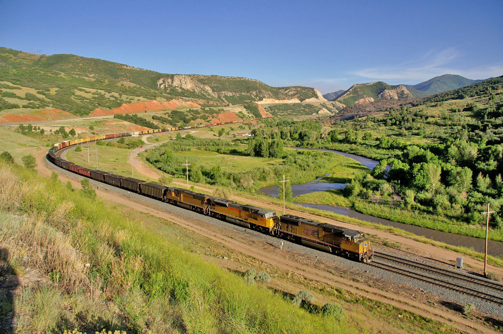 A UP freight rolls through the former town site of Thistle Utah. In 1983 a gigantic mud slide buried the town and railroad at this location.
