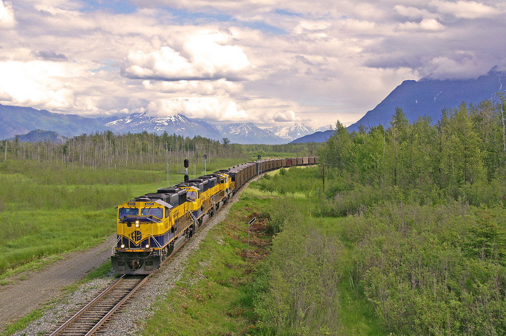 An empty coal train rolls north at Matanuska junction in the heart of the Mat-Su Valley one of Alaska fastest growing areas. Late spring can bring dramatic skies to Alaska but in general is a fine time for photography as everything has greened up after the long winters.