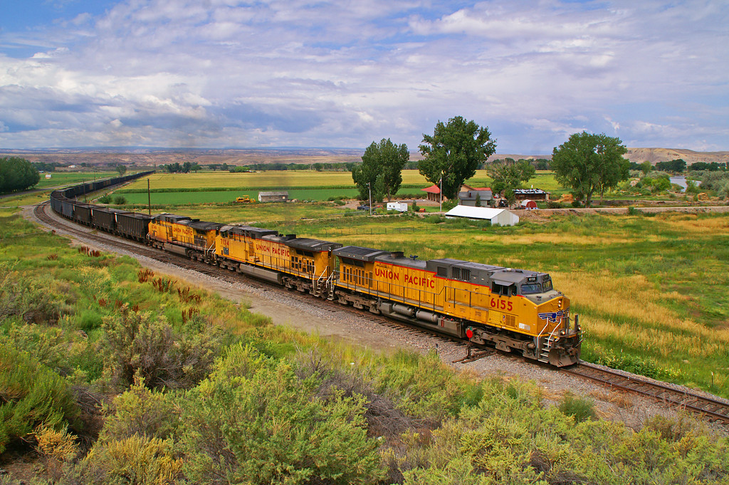 An empty coal train is headed for the mines seen here passing a farm in Roubideau, Colorado.