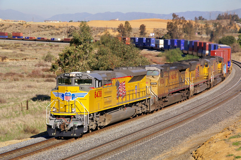 A UP doublestack train rolls through the curve eastbound at Apex, CA