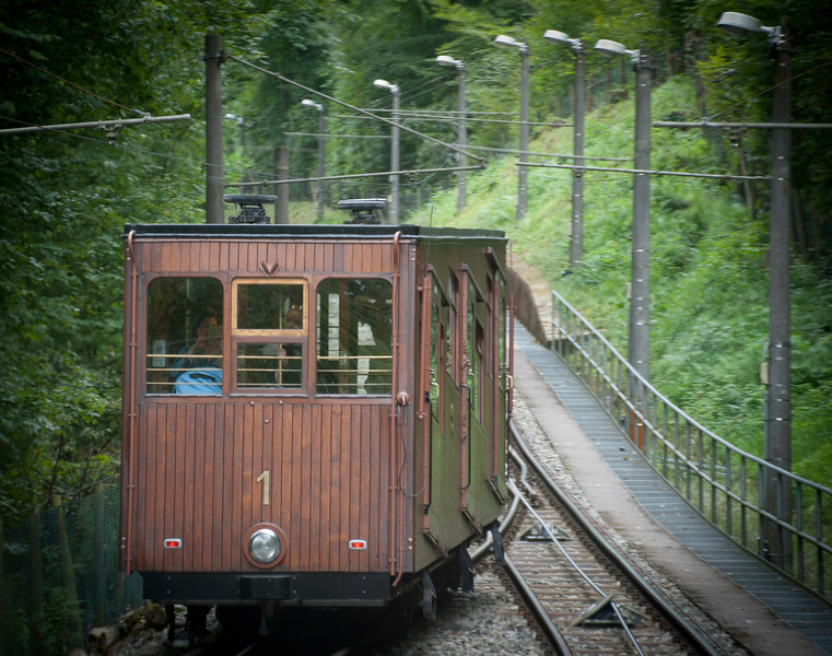 Stuttgart hosts a remarkable funicular built in 1929 whose teak carriages, with an undertaker's circumspection, ascend the hill to the cemetery. The last inches like the silence at the end of the service.