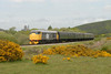 31108 2S07 1150 Norden ~ Swanage departs Corfe Castle and heads across the common 1155 10/05/09
