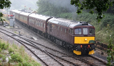 In torrential rain, 33025 departs Norden with the 1023 Swanage - Norden 28/6/17