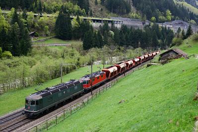 11646 + 11351 haul northbound Holcim hoppers at Gurtnellen 28/4/15.