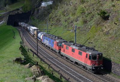 11335 + 620069 haul a northbound intermodal above Wassen 30/4/15.