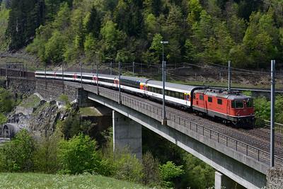 Train IR2324 the 11.47 Locarno-Basel passes Almen behind 11159 29/4/15.