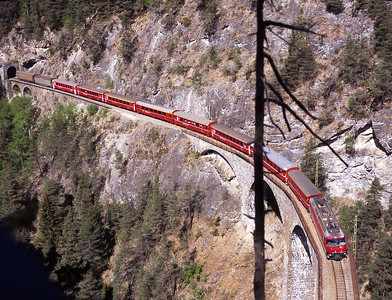 Balanced precariously above the tunnel mouth, 651 passes with the 09.58 Chur-St.Moritz 3/5/07.