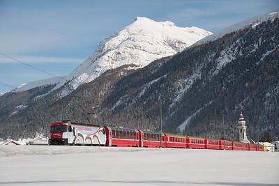 650 hauls the 13.02 St.Moritz-Chur from bever towards the Albula tunnel 15/1/10.