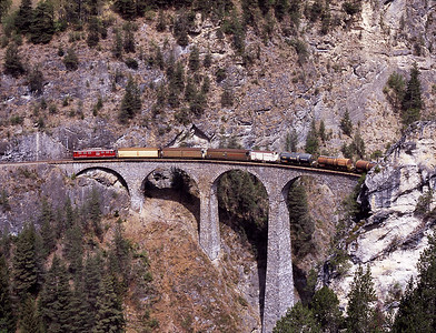 An unidentified 701 crosses the Landwasser viaduct with a northbound freight 3/5/07.