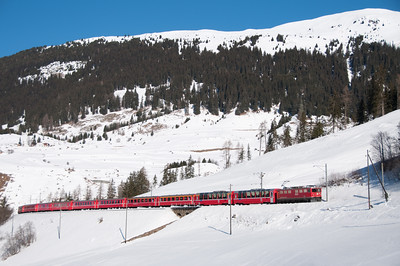 The 701s are now rare on passenger trains although this was a booked working at the time; 706 drops down to Bergün with the 11.02 St.Moritz-Chur 16/1/10.