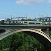 "A BLS EMU crosses the Aare bridge. The articulated centre car in the new livery is a ""Jumbo"" car rebuilt from two EWi coaches."