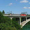 A SBB Re460 heads west across the Aare bridge on a rake of EWiv stock.