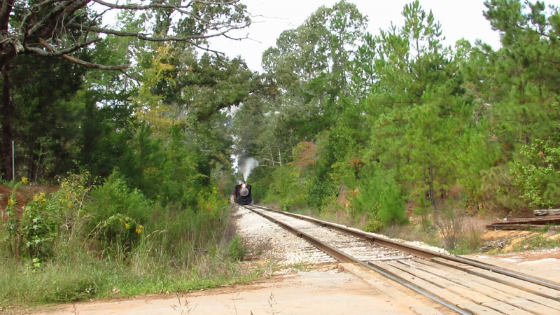 Running from Rusk to Palestine, Texas, engine 316 of the Texas State Railroad is making good time with its eastbound train as it whistles its presence and approach to a rural Lone Star State grade crossing on a sultry Saturday, 10-26-13.