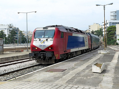 OSE's Adtranz/Bombardier 220 033 arrives into Athens Larissa with an Intercity service from Thessaloniki. The new electrified line and station is built on the left hand side. Wednesday 7th June 2017.