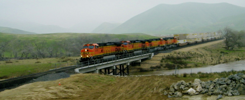 After the night's layover at Bakersfield there wasn't a whole lot of rail activity over the pass on 1-9-11.  But as we headed up we did see this northbound stack train heading down, and crossing this brand new bridge over Tehachapi Creek.