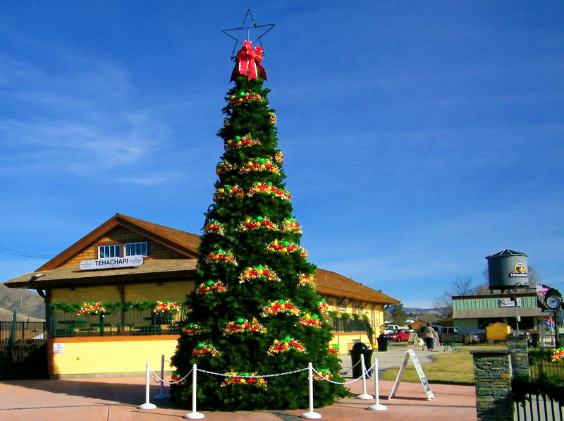 Civic Xmas tree (January) in front of depot/museum in its 3rd life (original, rebuilt and burned down, this one).  Old water tower at right.