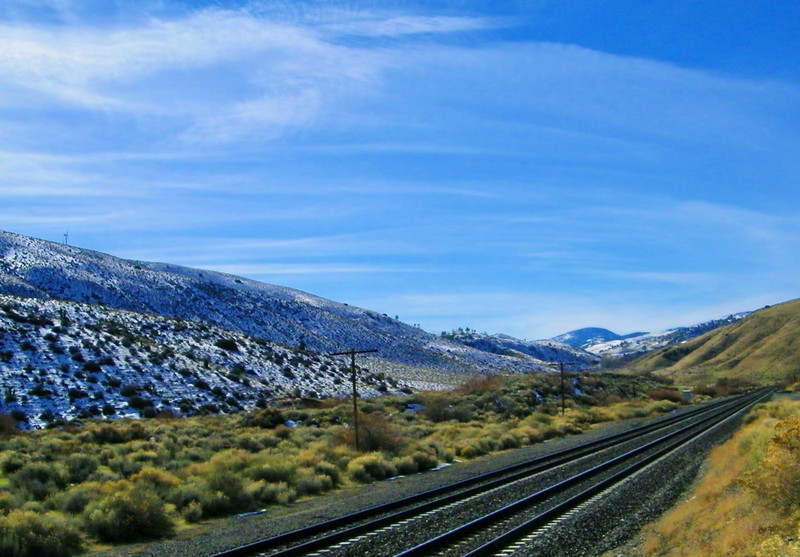 Yes, that's snow on the ground; low elevation, too.  Hey, I SAID it was cold!!  This view is about 180 degrees from the previous shot, of the stopped freight.