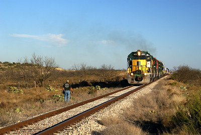 Conductor waiting for train to come to a stop north of Barnhart, TX.  This is as far as the train will go today.