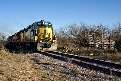 Passing an old stockyard loading chute at a former siding named Suggs.