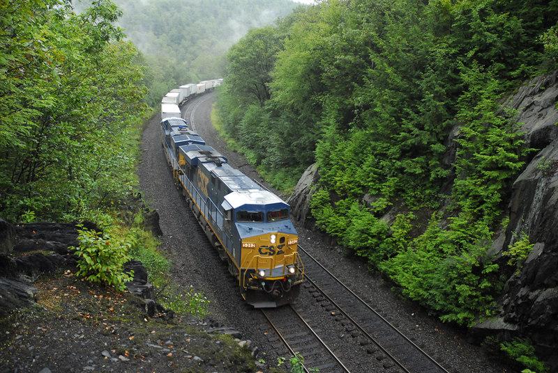 CSX Q119 climbing Washington Hill through the 128 cut in Chester MA. August 26, 2006. Powered by a pair of new ES44DCs 5342 + 5383