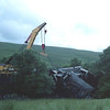 This picture taken on 17/7/1998 during the Dent Head derailment clean up Cowans Sheldon 75ton breakdown crane from Toton sorting out the mangled mess of MGR wagon
