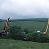 This picture taken on 17/7/1998 during the Dent Head derailment clean up shows the Cowans Sheldon 75ton breakdown cranes from Toton (on the left) and from Thornaby (on the right) sorting out the mangled mess of MGR wagons.