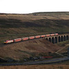 A pre dellner 57304 Gordon Tracy passes over Dandry Mire Viaduct with the diverted 10:05 Euston to Glasgow service 9/2/2003.
