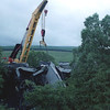 This picture taken on 17/7/1998 during the Dent Head derailment clean up Cowans Sheldon 75ton breakdown crane from Toton sorting out the mangled mess of MGR wagons.