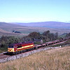 56067 passes the site of Garsdale troughs with a rail train, 14/9/2002.