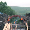 While the other two workmen are being untied from the digger the other workmen change their angle of attack on the remaining arch of bridge of 87 with their pneumatic drills. 18/7/1998