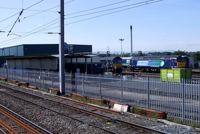 The north end of Kingmoor shed, with the fuelling point visible, and 66433 and 57010 ,11/07/09.