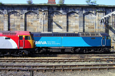 Two Class 57/3s, one in Virgin Trains livery and one in Arriva Trains Wales livery, at Carlisle, 11/07/09.