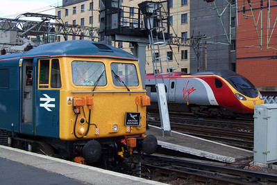 "The old and the new for the West Coast Main Line, the Class 87 electric loco versus the Class 390 ""Pendolino"" electric multiple unit, 11/07/09."