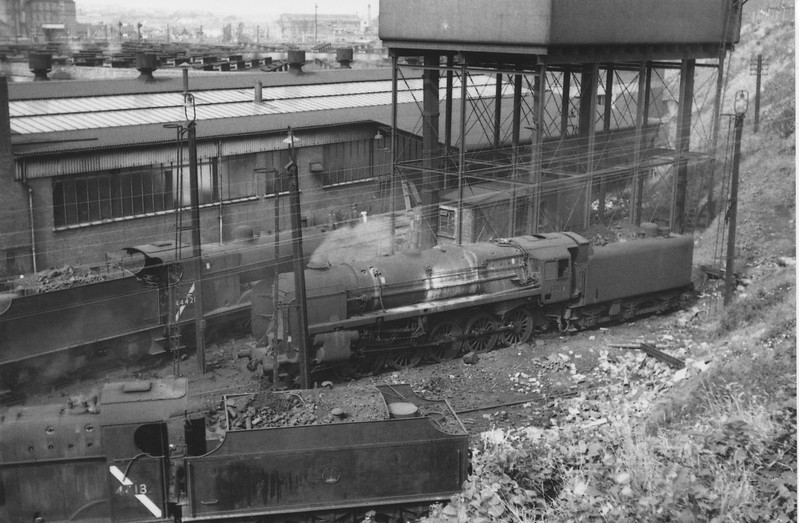 Leicester Midland shed (closed to steam in June 66) as viewed from the adjacent steep walkway on 24/08/64. Coalville's 4F 44421 and Leicester's 44182 were both withdrawn by the end of that year - with Leicester's 92089 being withdrawn at Birkenhead in 02/67.
