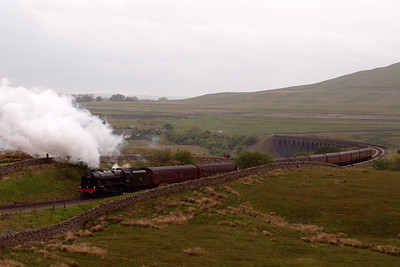 46115 Scots Guardsman climbs away from Ribblehead viaduct towards Blea Moor signalbox, on the climb to Ais Gill summit.
