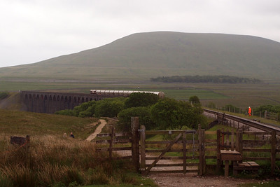 66104 heads south over Ribblehead Viaduct with 4M00 Mossend - Clitheroe cement tanks.