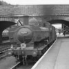 Ex GWR pannier 0-6-0PT 4694 at Exeter Central on 11/07/64 - having just assisted a service up the 1 in 36 bank from Exeter St Davids. This Exmouth Junction allocated tank was withdrawn 11 months later.