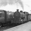 """The """"axis"""" of the S & D, Evercreech Junction, was visited on 25/04/64.Templecombe allocated ex LMS 0-6-0 44422 is seen departing with the 11 40 Bournemouth West to Bristol Temple Meads - she being withdrawn from Gloucester in May 65."""