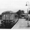 The 17 15 departure from Lyme Regis to Axminster awaits departure, the 19 minute late start resulting from the driver having to attend to a minor fault, on 11/07/64. This branch was closed in November 1965.