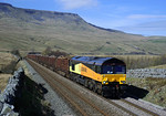 'Colas Rail' 66845 finally reaches the summit at Ais gill in charge of 6J37 in some very nice light.06/04/2011.