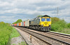 Freightliner 66589 powers 4O02 Lawley St-Southampton liner past Thurley farm crossing near Mortimer 18 May.