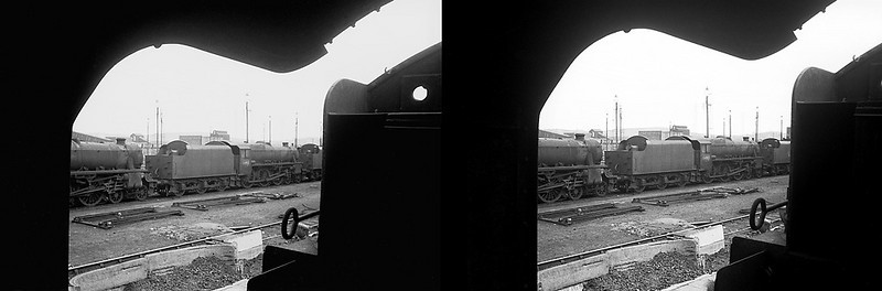 "Seen from the cab of dumped WD 2-8-0 No. 90642, a line-up of stored ""Black 5"" 4-6-0s includes No. 44912 at Wakefield MPD, all the engines awaiting their fate. April 1968."