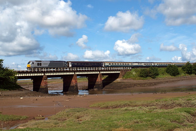 67013 Dyfrbont Pontcysyllte and the Three Peaks crosses the River Mite viaduct at Ravenglass.