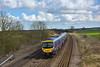 185116 approaching New Barnetby with 1B77 11.26 Cleethorpes to Manchester Airport service