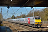 DVT 82223 speeds through Welham Green at the head of 1E06 the 06.50 from Glasgow Central to  Kings Cross<br /> Although the DVT has been overbranded with Virgin the stock remains in the former East Coast livery for the time being.<br /> <br /> 10 March 2015